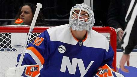 Robin Lehner of the Islanders looks on after
