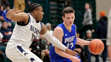 Port Washington guard Marc Daly moves into the
