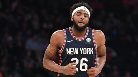 Knicks center Mitchell Robinson runs up court against