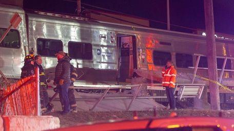 Emergency crews work on a LIRR derailment at