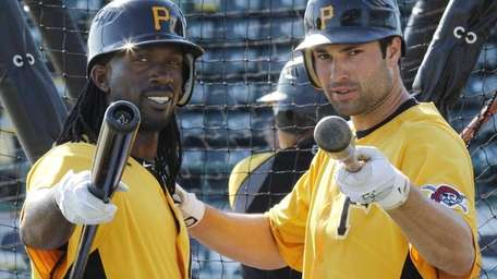 Pittsburgh Pirates' Andrew McCutchen, left, and Neil Walker