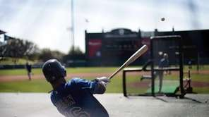 The Mets' Angel Pagan takes batting practice before