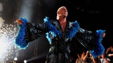Ric Flair is greeted by the crowd during
