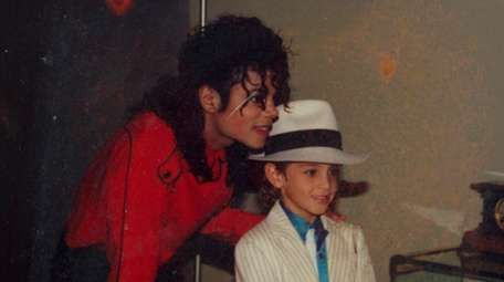 Michael Jackson and Wade Robson in a scene