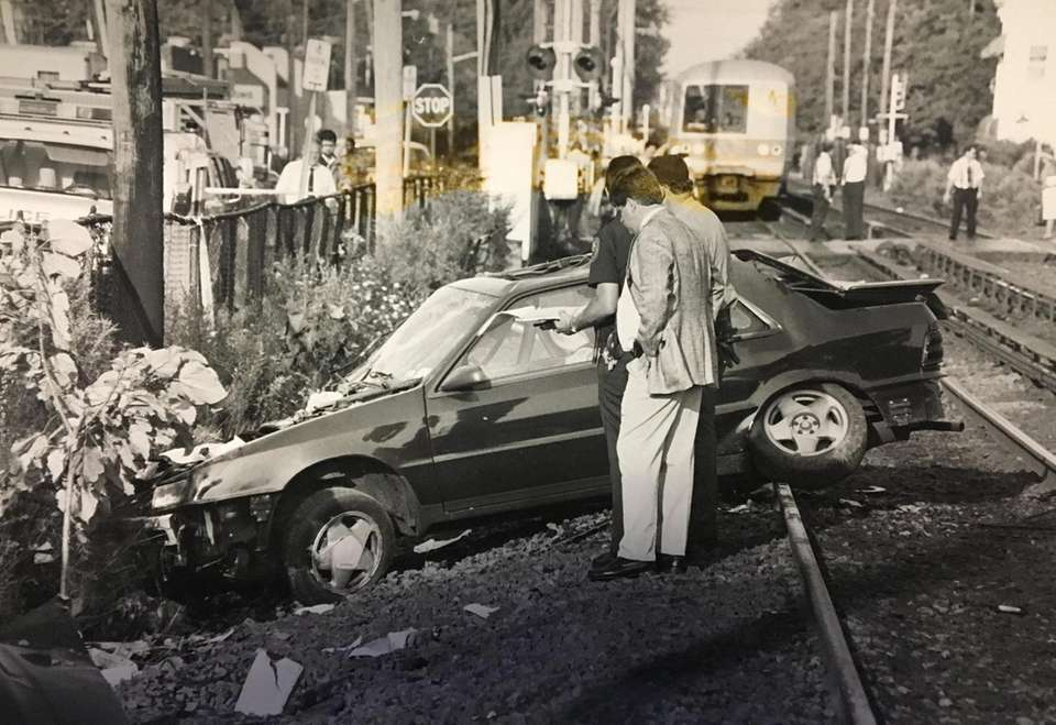 Police investigate the wreckage of a car that