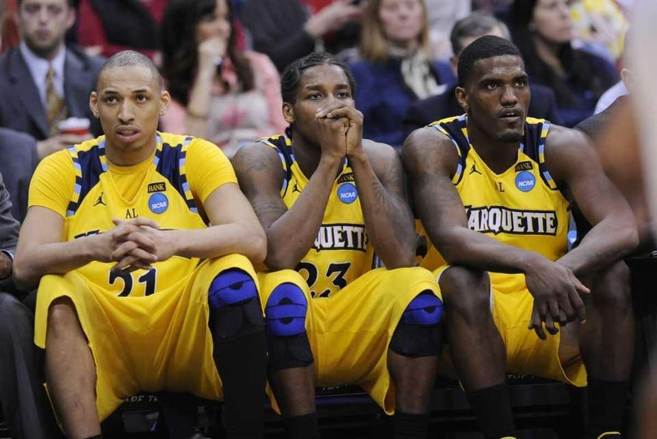Marquette's Joseph Fulce, left, Dwight Buycks, center, and