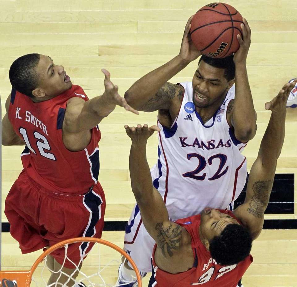 Kansas' Marcus Morris shoots over Richmond's Kevin Smith