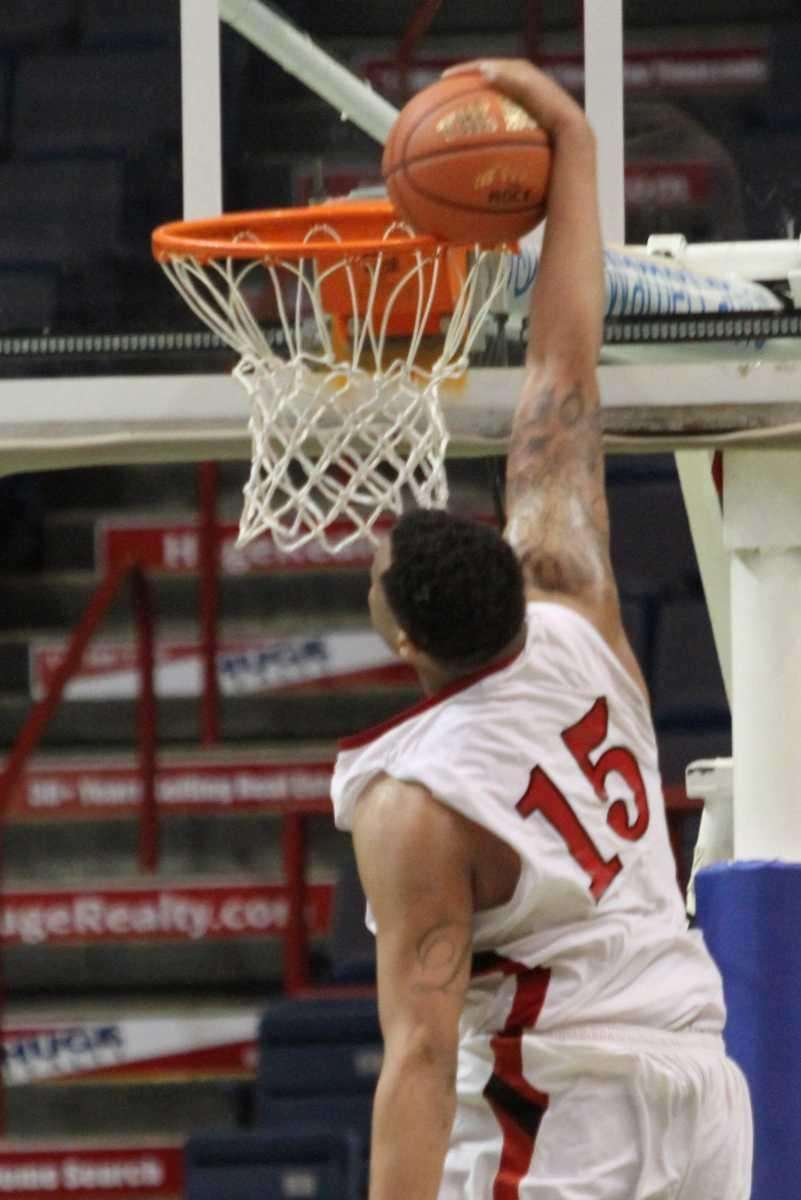 Jamesville-Dewitt's Dajuan Coleman misses a dunk during their