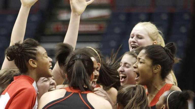 Long Island Lutheran players celebrate after their 59-57