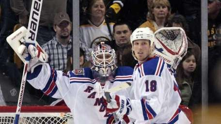 Rangers goalie Henrik Lundqvist, left, celebrates with defenseman