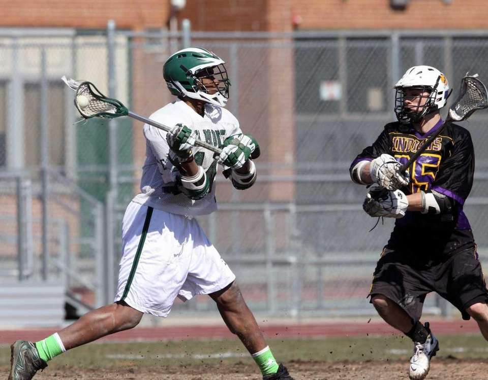 Elmont's Qusarn Caldwell fires shot in front of