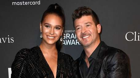 Singer Robin Thicke and his fiancee April Love