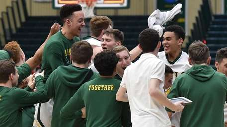 Lynbrook teammates celebrate after their 51-40 win over