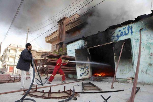 Libyan men fight a fire in the city