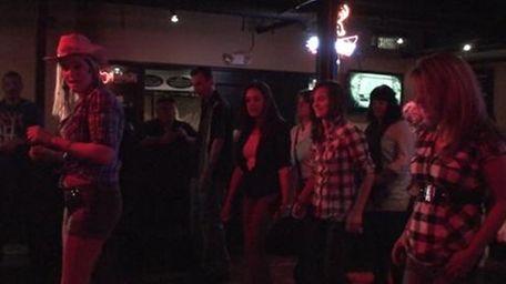 Line dancing instructor Lauren Leggio leads a group