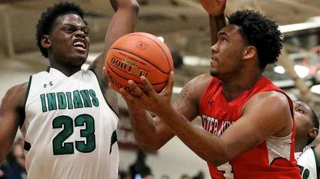Center Moriches Micah Snowden gets fouled on the