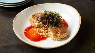 Jumbo lump crab cakes are boosted by pickled