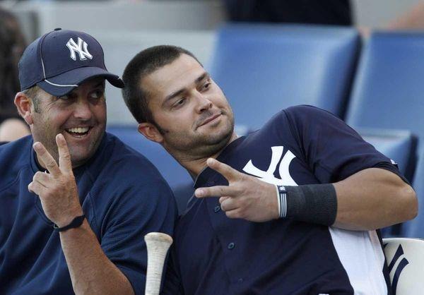 New York Yankees batting coach Kevin Long, left,
