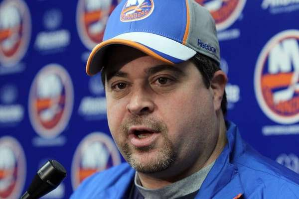 Islanders head coach Jack Capuano speaks to the