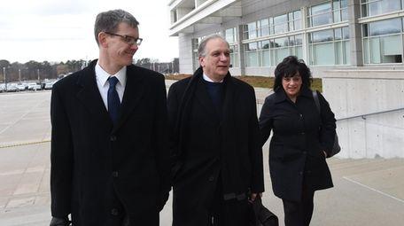 Attorney Matthew Brissenden, left, arrives with Edward and