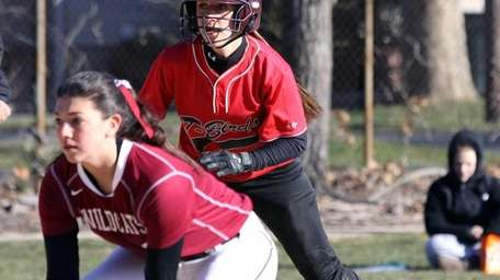 Connetquot's Amanda Schoenfeld running the bases behind a