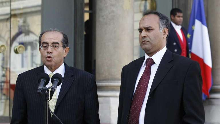 Mahmoud Jibril, left, and Ali Al-Esawi, representatives of