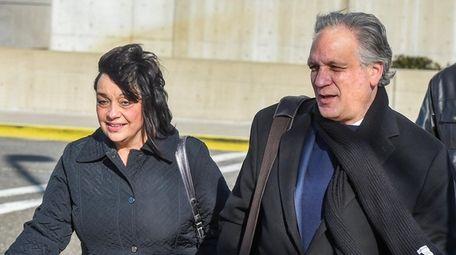 Linda and Edward Mangano leave federal court in