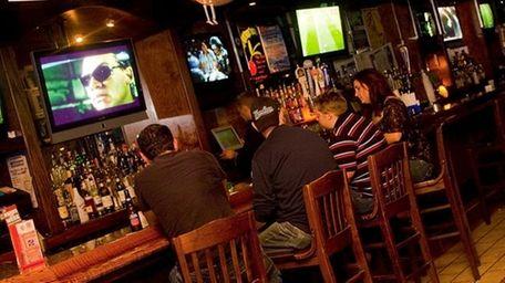 A crowd gathers at the bar at Napper