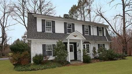 This Colonial, for $899,000, includes four bedrooms and