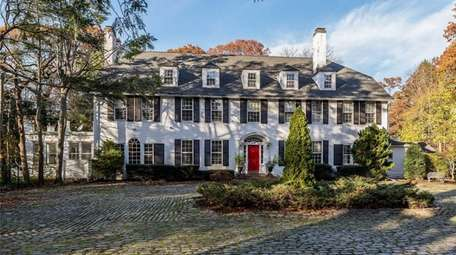 This Colonial, for $1.699 million, includes six bedrooms.