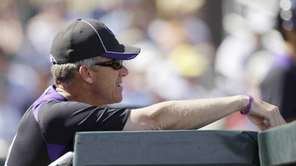 Colorado Rockies manager Jim Tracy watches from the