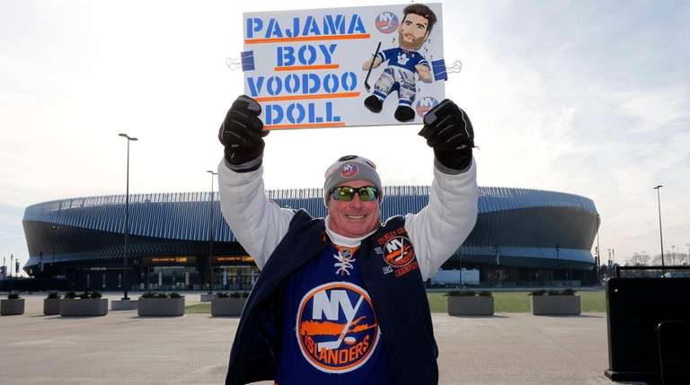 Patrick Dowd of Bayshore holds a banner in