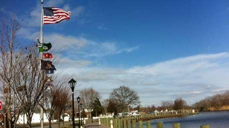 The Peconic River runs parallel to Main Street