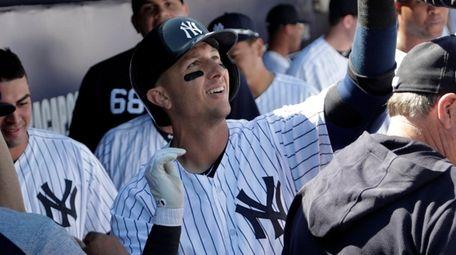 The Yankees' Troy Tulowitzki celebrates in the dugout