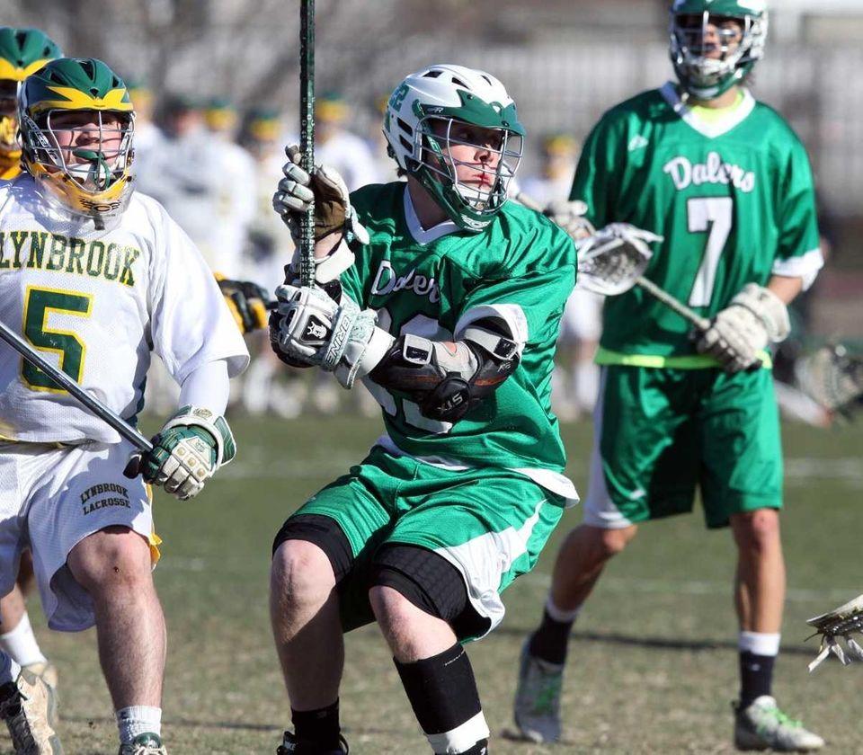 Farmingdale's Travis Wahl nears the net. (March 29,