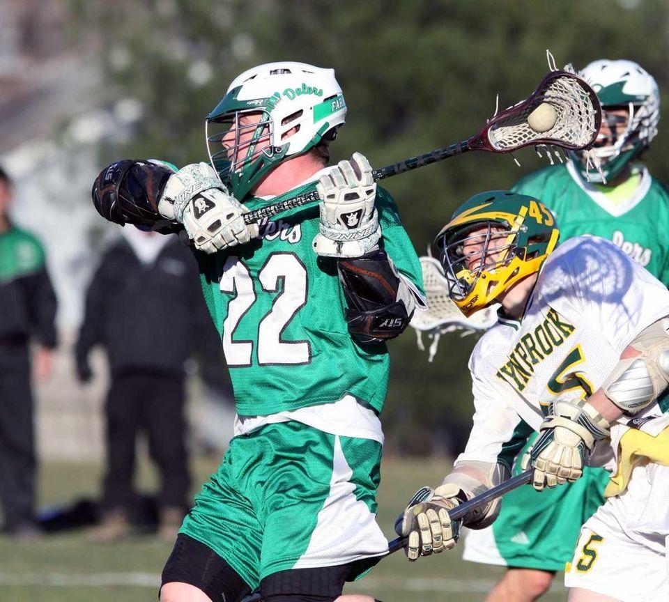 Farmingdale's Travis Wahl nears net during Nassau boys