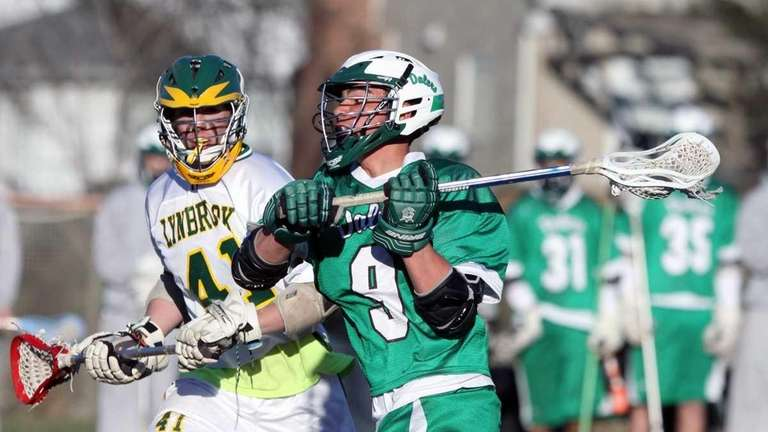 Farmingdale's Mike Perrettine readys for the shot during