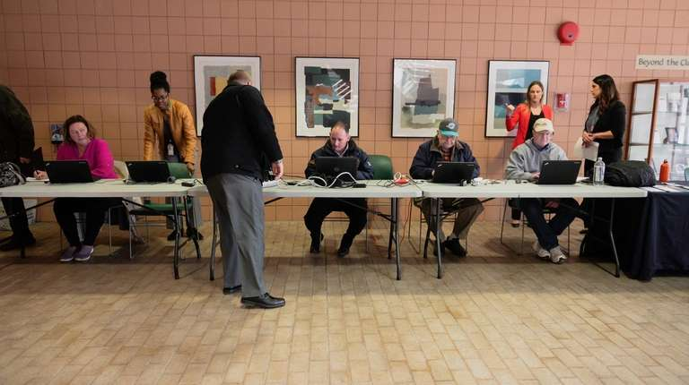 Attendees at a job fair in Brentwood apply