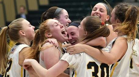 Wantagh teammates celebrate after their 42-35 win over