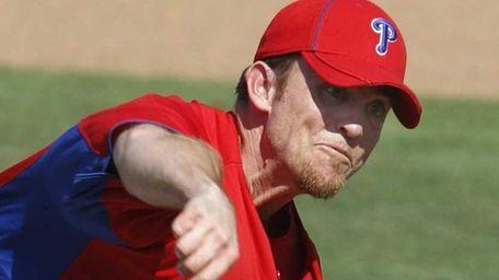 Philadelphia Phillies pitcher Brad Lidge throws in the