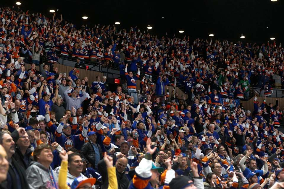 New York Islanders fans cheer after a goal