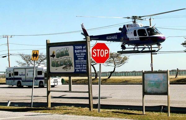 Suffolk County police scour an area near Gilgo