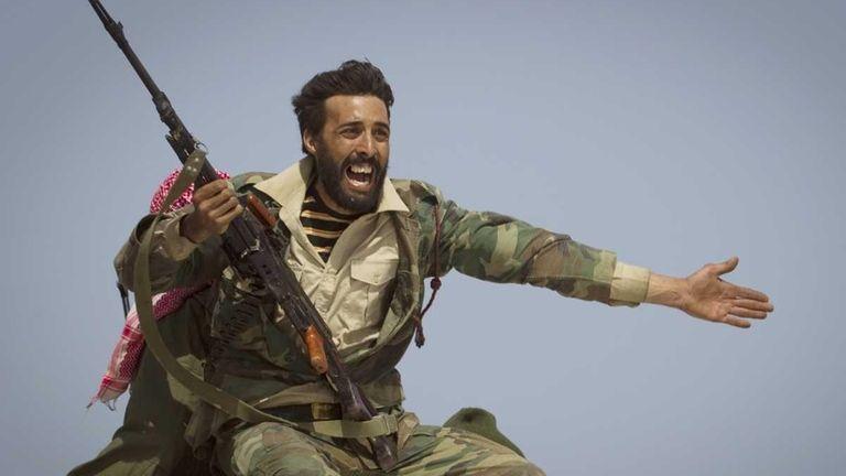 A Libyan rebel urges people to leave, as