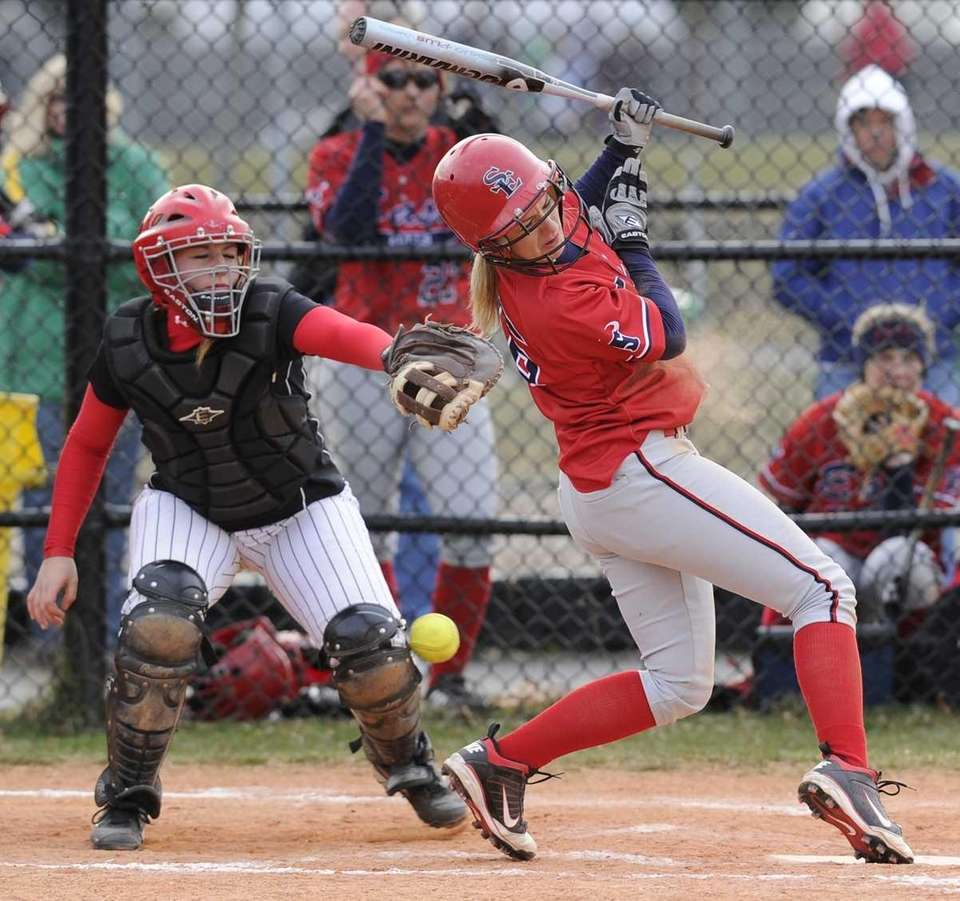 Smithtown East 's Madison Provencher gets hits by