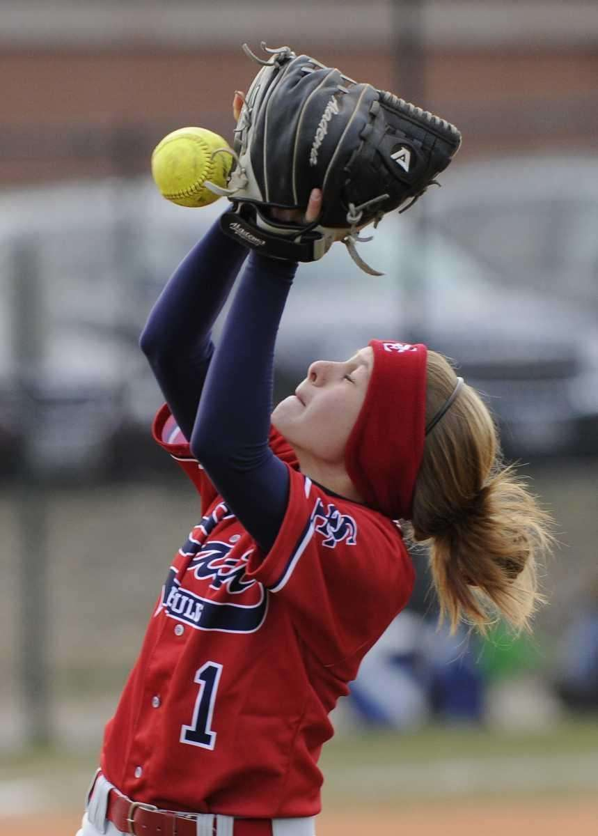 Smithtown East 's Holly Russell can't handle a