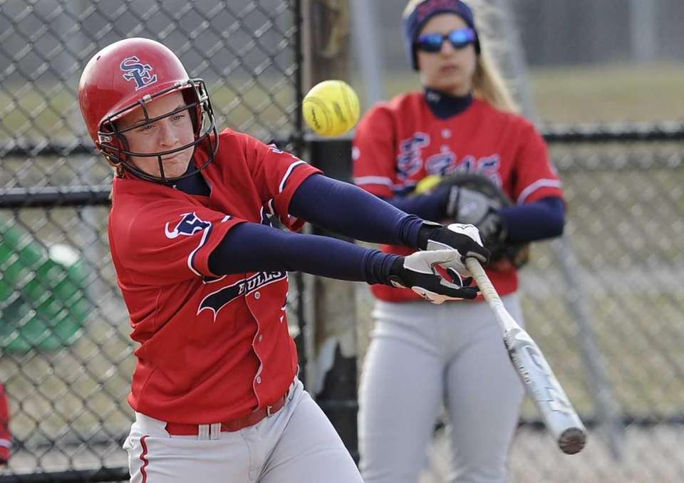Smithtown East's Francesca Busa hits against East Islip