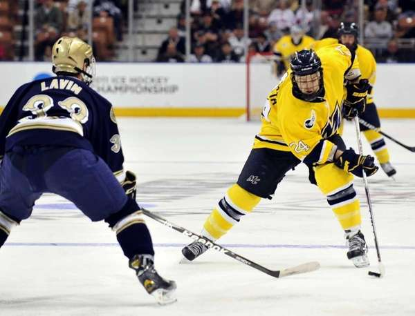 Merrimack forward Stephane Da Costa tries to carry