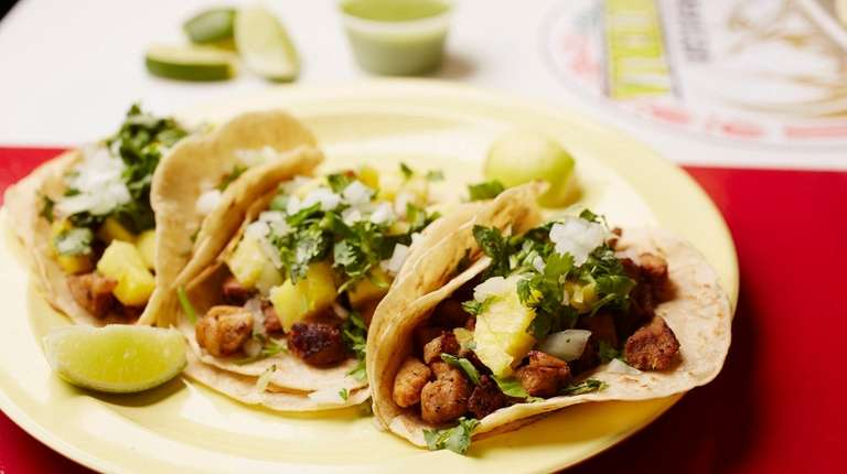 Tacos al pastor on corn tortillas at Nelly's