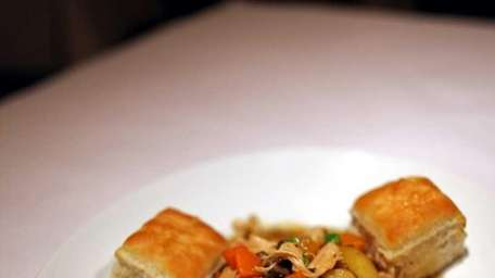 Savory pulled chicken, nearly a stew, is served