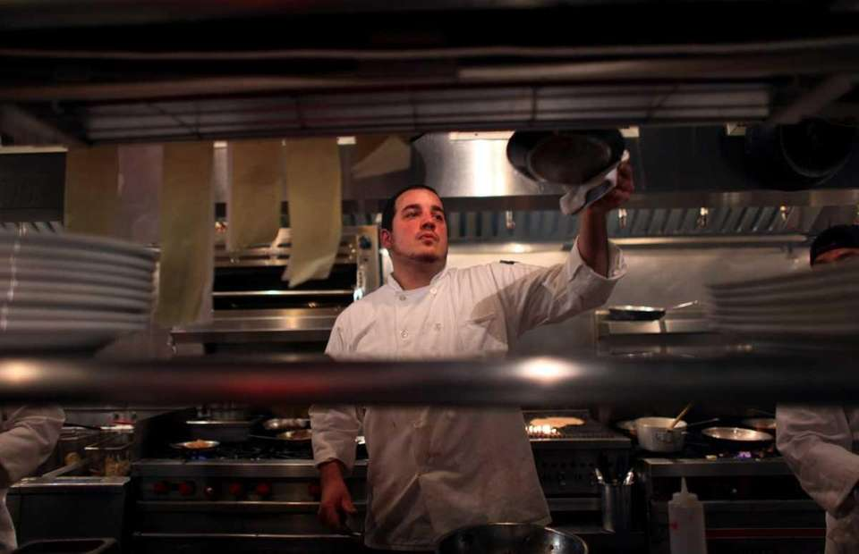 Chef Richard Soriano cooks in the kitchen of